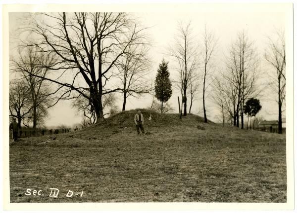 Fort Ancient, man standing by mound photograph