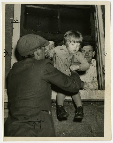 Portsmouth 1937 flood, young child rescued photograph