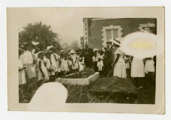 Bishop Dougal Ormonde Beaconfield Walker, Reverend Higman and unidentified individuals at the grave of Reverend Cole, which is located in the cemetery of the Kingstown Methodist Church in the West Indies