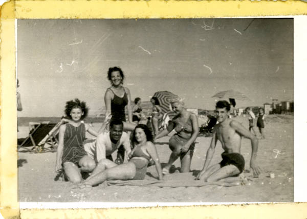 People on a beach in Italy photograph