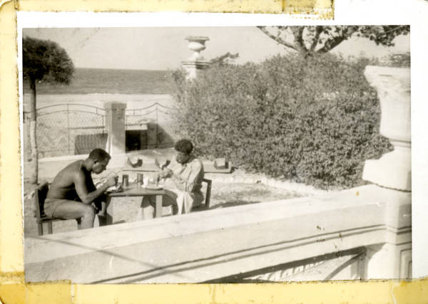 Bernard S. Proctor and friend eating outside in Italy photograph