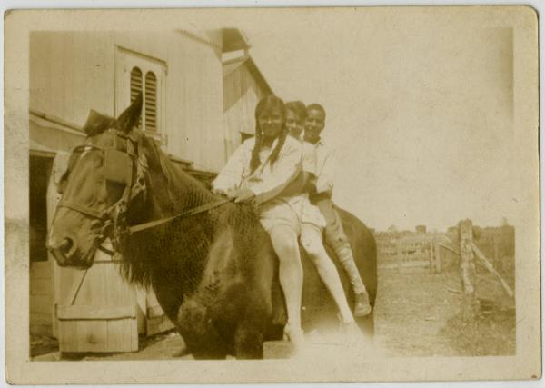 Charles Noel and Marie Young on horseback with unidentified girl photograph