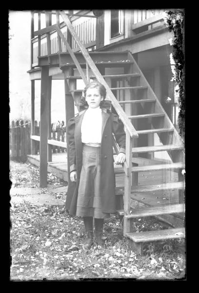 Young girl by staircase