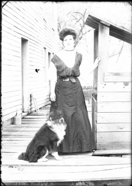 Woman and dog on porch