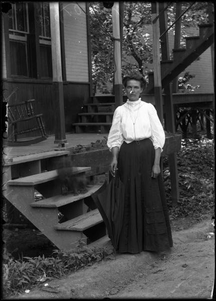 Woman by porch photograph