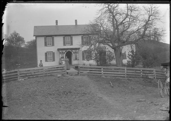 Women and house photograph