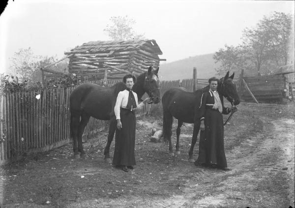 Women leading horses photograph