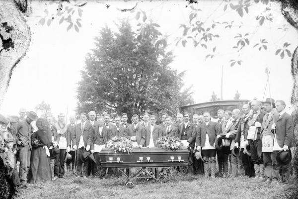 Mourners in cemetery photograph