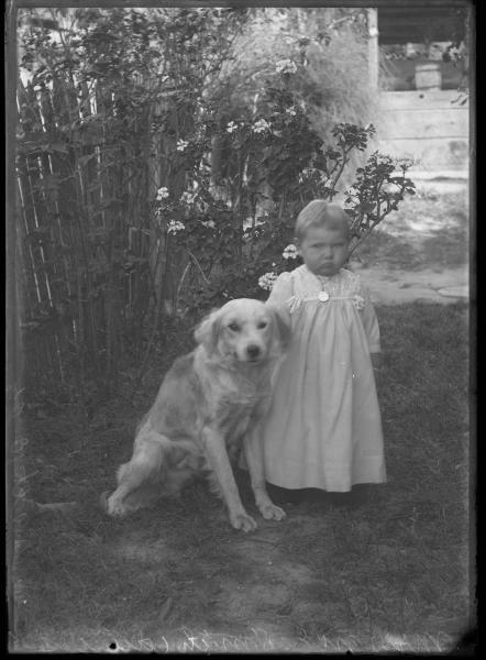 Toddler and dog portrait
