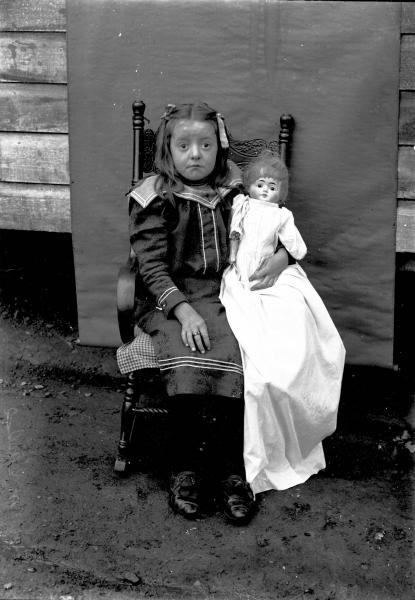 Girl and doll portrait