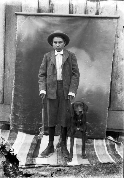 Boy with dog and rifle