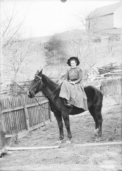 Woman on horseback photograph