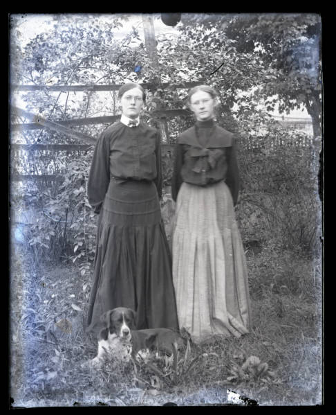 Two women with dog photograph
