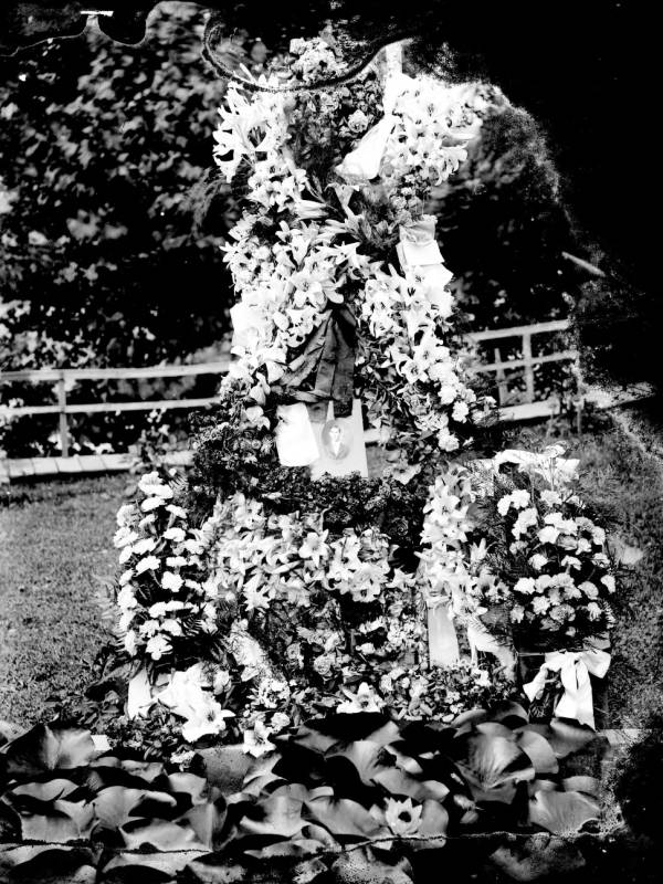 Memorial flowers and photograph