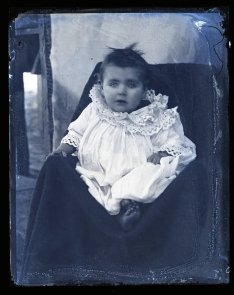 Infant in white gown portrait