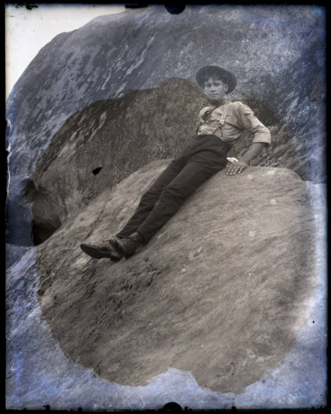 Young man on boulder portrait