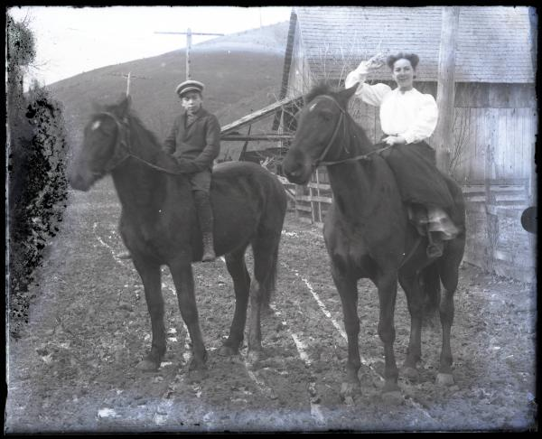 Two unidentified people on horses