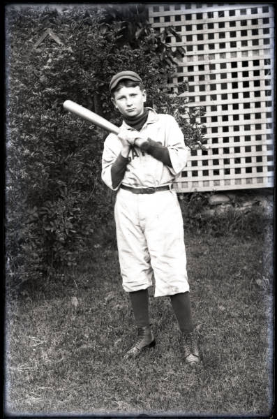 Boy in baseball uniform