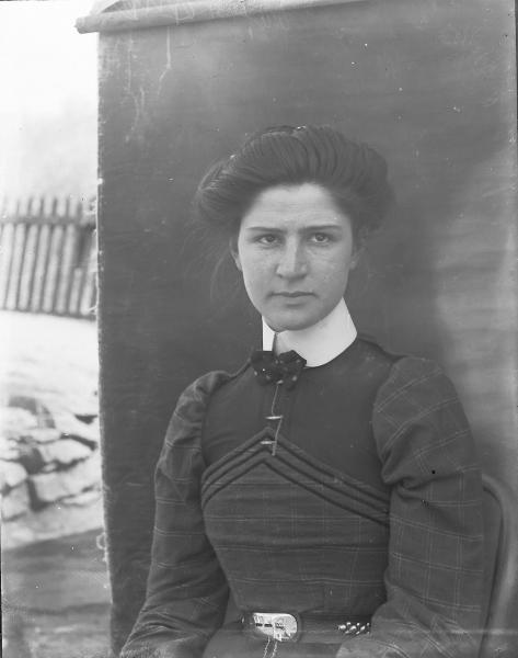 Woman wearing an unlocked belt photograph