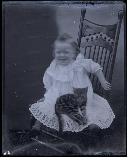 Girl seated with her cat