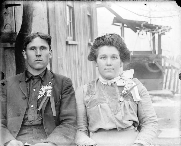 Man and woman wearing flowers