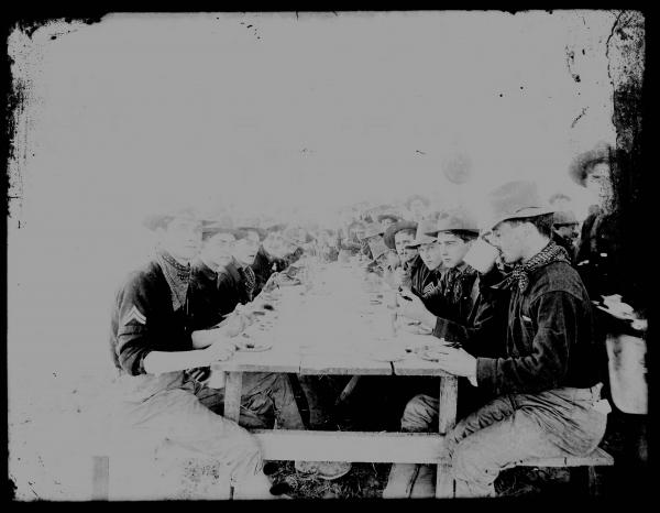Soldiers at mealtime photograph