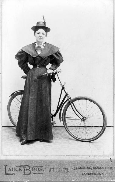 Woman with bicycle photograph
