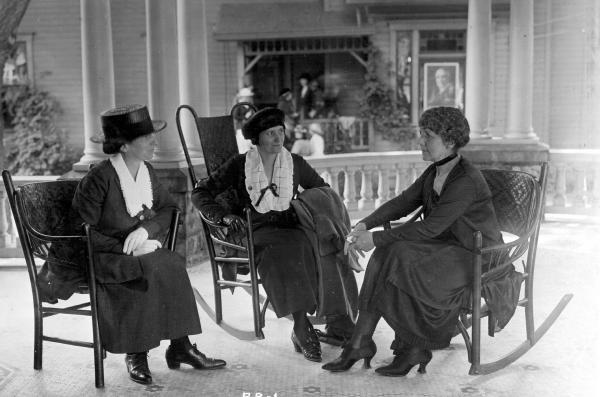 Florence Harding and two women on her front porch