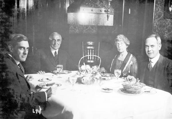 Warren G. and Florence Harding dining with guests photograph