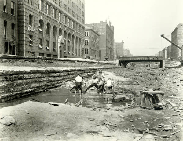 Boys playing in old Miami and Erie Canal bed