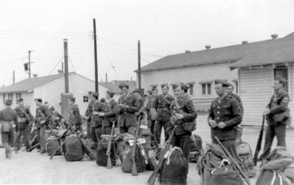 Soldiers waiting for the train photograph