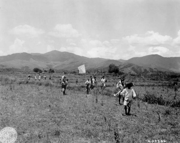Filipino villagers carrying truce flag