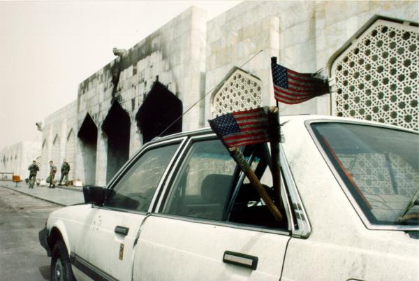 Burnt and torn American flags in Kuwait