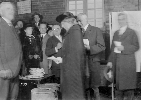 Warren G. and Florence Harding voting photograph