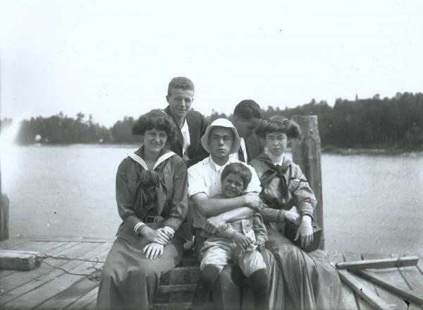 Young people on dock photograph