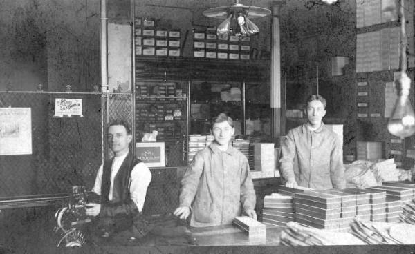F. & R. Lazarus Company employees with the first foot-powered pin ticket machine