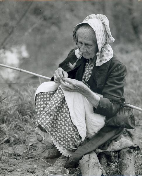 Old woman with fishing pole