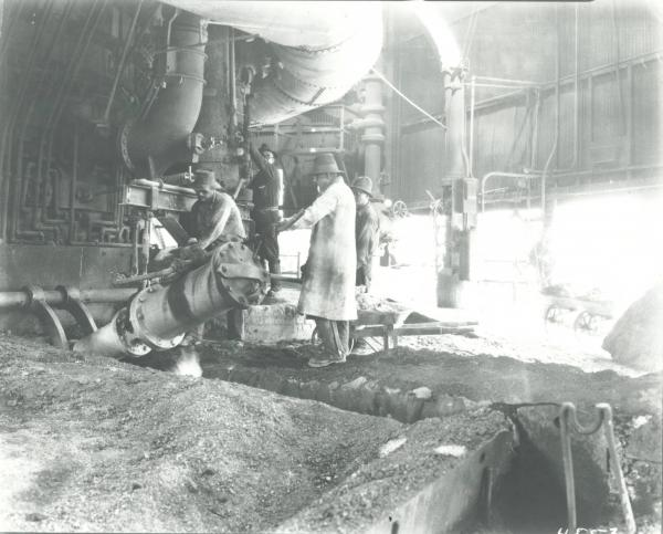 Youngstown Sheet and Tube Company's Campbell Works steelworkers operating a mud gun