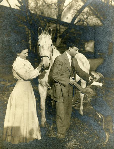Couple with horse and dog