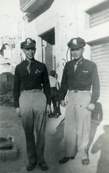 Harry C. Pepon with soldier posing in uniform