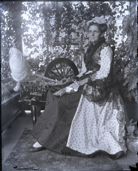 Mrs. Frazar by spinning wheel photograph