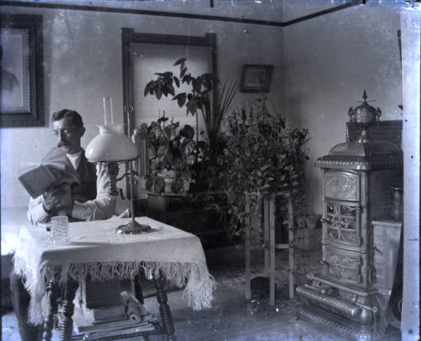Man reading in parlor