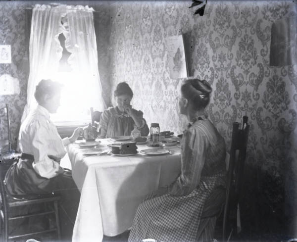 Three women at a table photograph