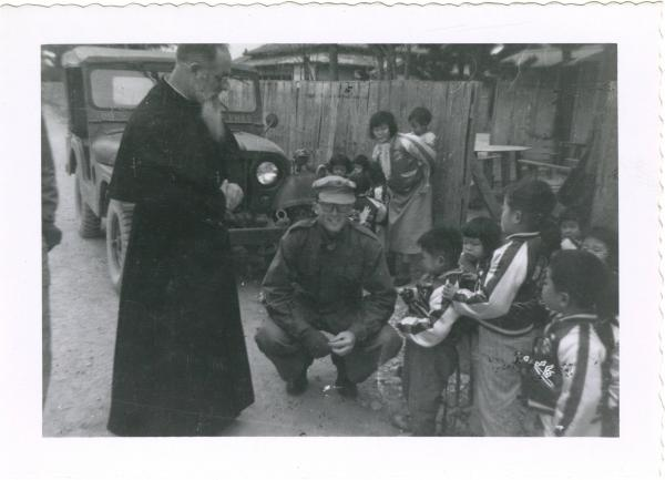 French Priest and Michael Petrucci at Korean orphanage