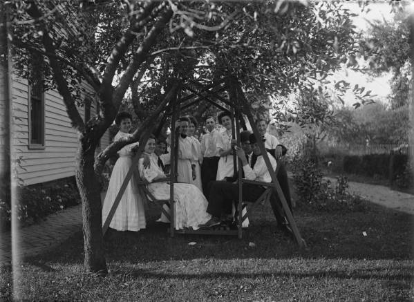 Adults on a swing photograph
