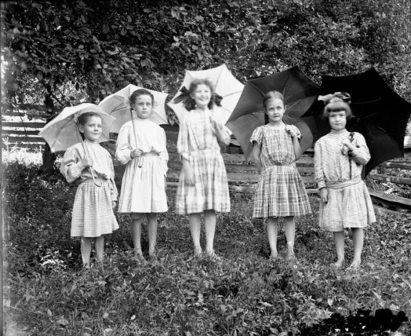 Five girls with umbrellas