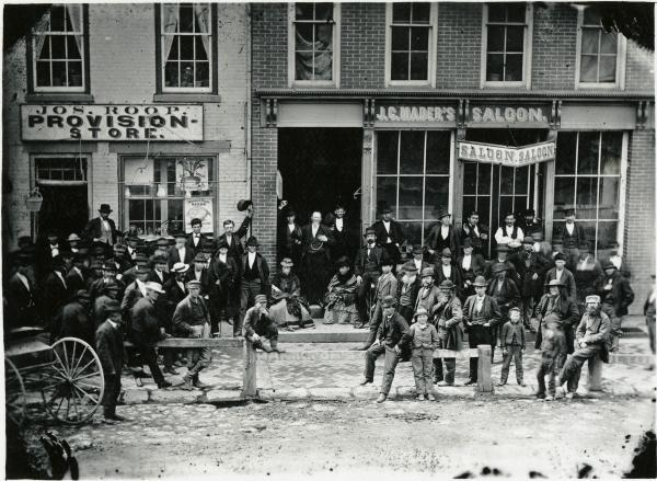 Temperance Crusaders outside of J. S. Mader's Saloon photograph