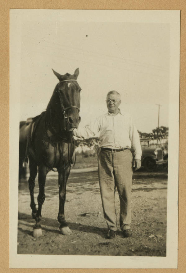 Man with horse photograph