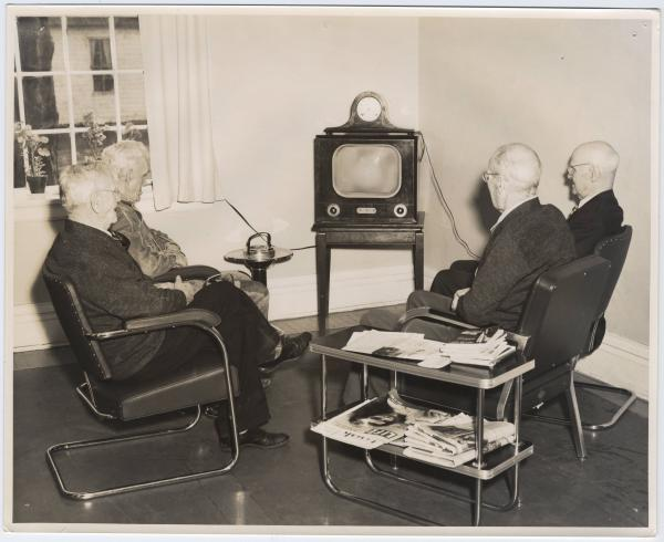 Deaf Home residents watching television