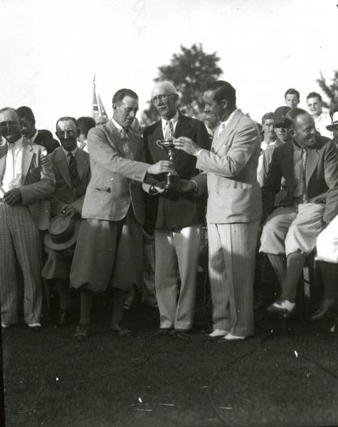 Men with golf trophy